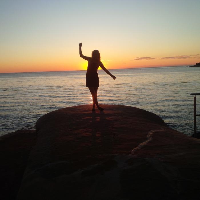 Photo of Maja Monroe, author of Awakening Her, at the Beach